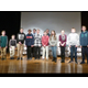 Geography Bee participants shown L-R are Aedan Rose Jason Costello Connor Kelley Jonathan  Powell Nathan Poitras Andrew Savage Rebecca Daigneault Jamie Costello Lucien Stenehjem and Nathaniel Smith back L-R 7th-grade teachers  program organizers Geoffrey Favakeh and Robert Marzilli