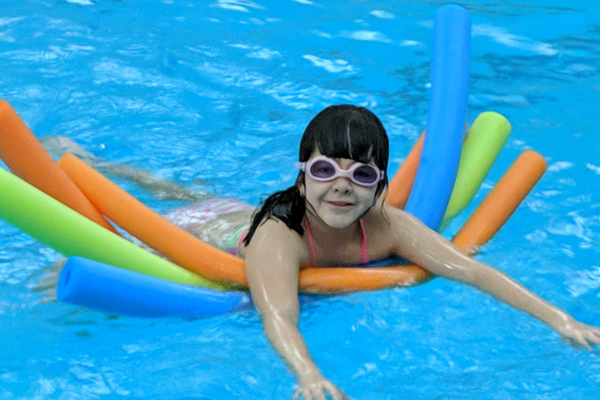 Emma Delgado uses her noodle to stay afloat during Tewksbury Congregational Church's pool party this past Sunday.  The Tewksbury Congregational Church provides family-friendly activities for church members, friends, and interested community members to get to know each other better. (Courtesy photo)
