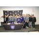 Michael Boddy center in hockey jerseyand his new teammates on the Holy Cross ice hockey team