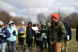 Permaculture specialist Mark Shepard instructs participants on planting food using symbiotic relationships on the landscape and between plants