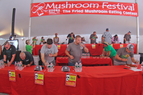A host of eaters compete for the $1,000 prize for eating the most mushrooms in eight minutes.