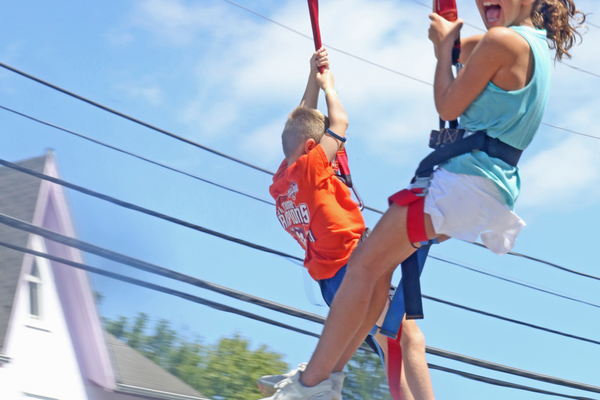 Excitement was high as kids (and some adults) took a quick ride down the zip line – a new event this year.