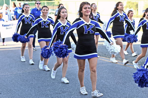 Cheerleaders followed closely after the band in the parade.