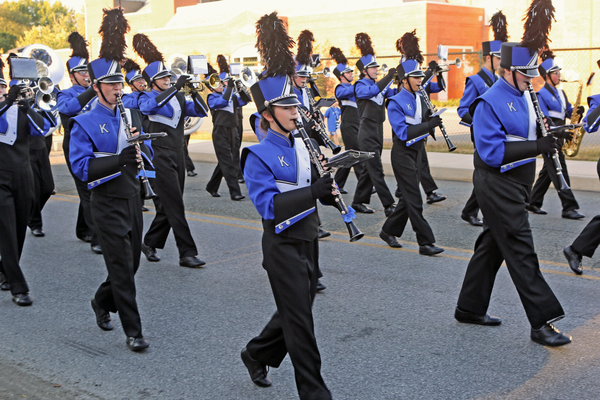 The Kennett High School Band marches in the homecoming parade and later plays for the game.