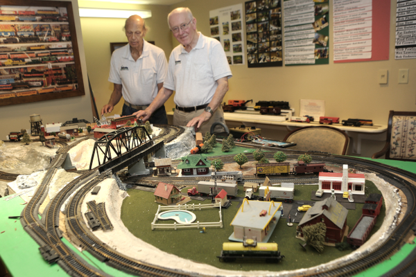 The smaller HO-gauge trains are overseen here by Bob Philhower (left) and Alan McIntyre.