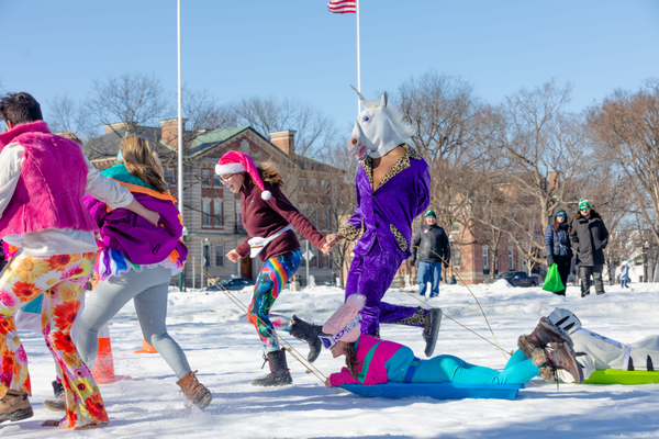 2019 Dartmouth Winter Carnival human dogsled races. Photos by Dartmouth College / Xiaoran (Seamore) Zhu.2019 Dartmouth Winter Carnival photos of WingDing acappella performance hosted by Sing Dynasty, polar bear plunge and ice sculpture carving contest.  Photos by Dartmouth College/ Robert Gill.
