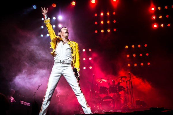 performer as Freddie Mercury onstage