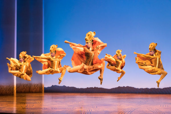 The Lion King dancers onstage