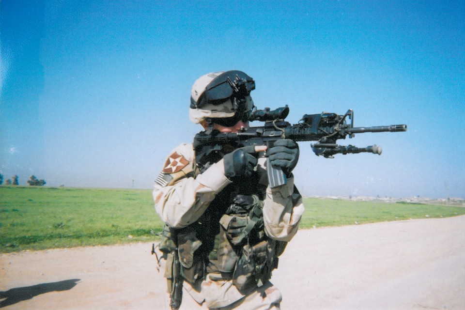 Jacob, age 20, ready for action in Fallujah, Iraq, 2004. Photo provided by Jacob Hausman.