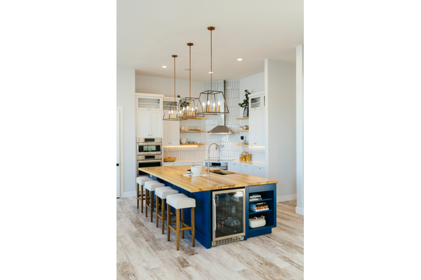blue kitchen island with wood top
