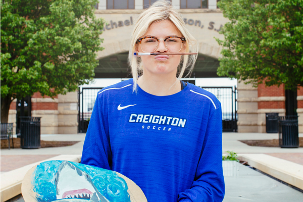 Creighton University sophomore Skylar Heinrich, paintbrush on lip