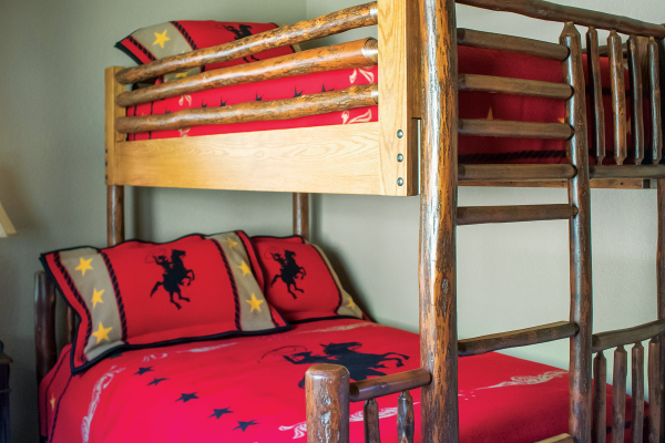 wooden bunk beds with red bedding