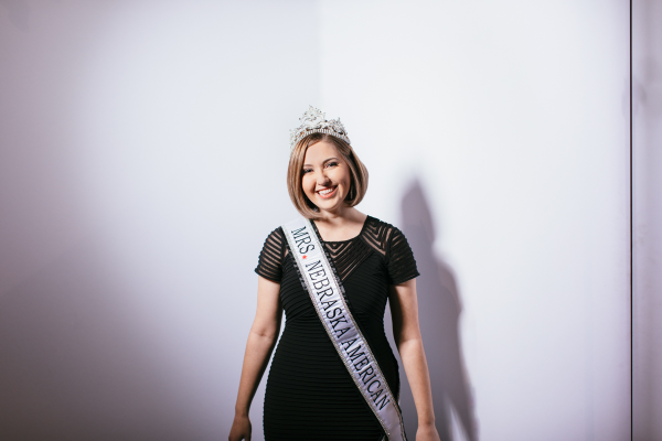 Lianna Austin, wearing crown, sash
