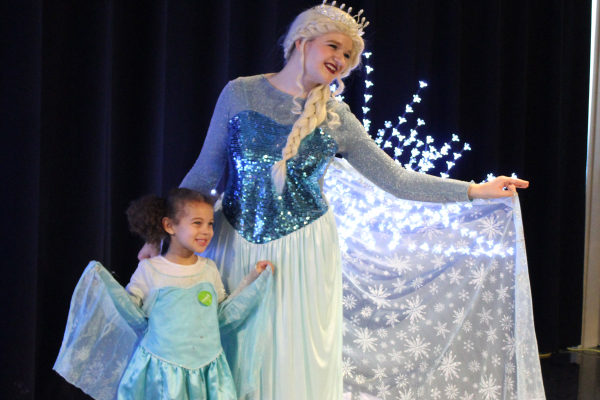 young girl with woman as Princess Elsa