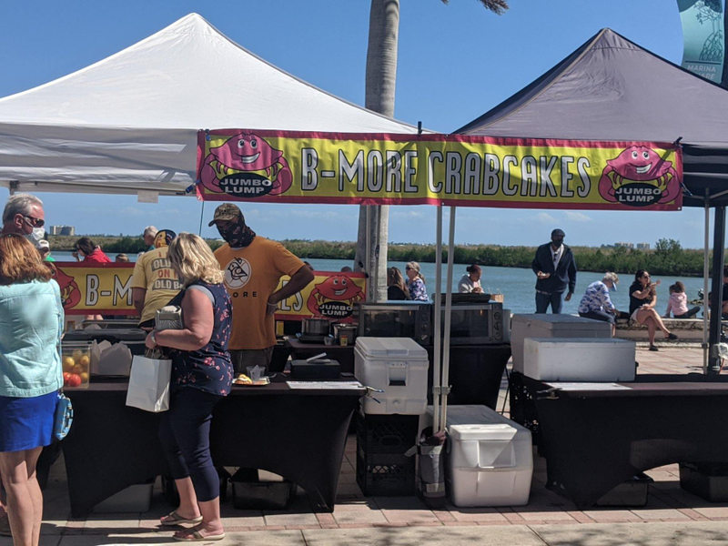 Vendors including B-More Crabcakes set up at the water's edge makes for a beautiful view while enjoying the Ft Pierce Farmers Market