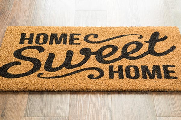 "Stock photo, picture of welcome mat with the words ""Home Sweet Home"""