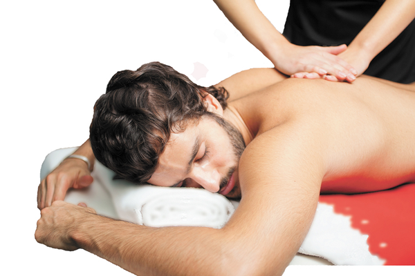 Athlete lying down on massage table receiving body work from therapist