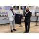 DDM Cannabis general manager Mark Mandracchia left and owner VictorPatel hold a new tee shirt with the dispensarys logo Masks and social distancing are required in the store