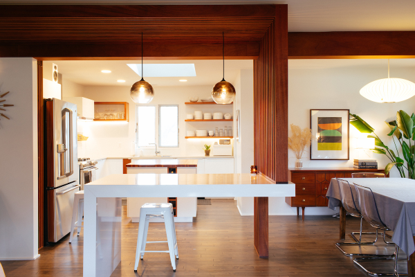Midcentury kitchen featuring white built-in table