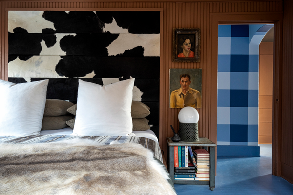 bedroom with cow print wall treatment