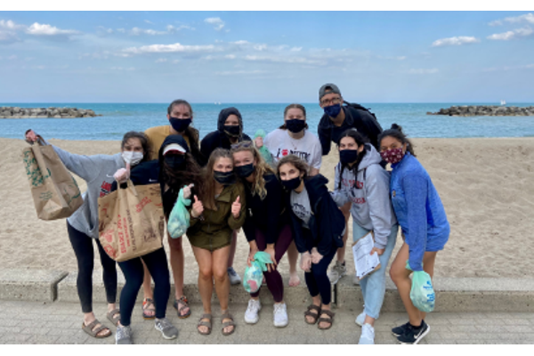 A group of people posing at a beach clean up