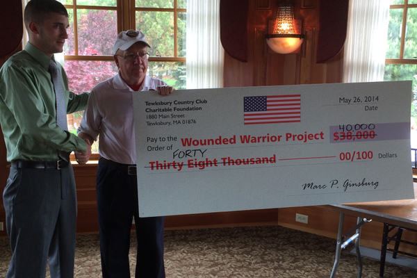 With the help of Marc Ginsburg and many other local sponsors the Tewksbury Memorial Day 5K Fun Run raised more than $40,000 for the Wounded Warriors Project. Nick Pearson and Jerry Selissen pose with the ceremonial check.