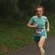 Women's winner Simonetta Piergentili prepares to cross the finish line at the Tewksbury Memorial Day 5K Fun Run.