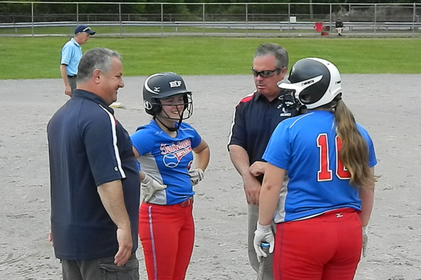 Senior captains Brooke Hardy and Shannon McLaughlin chat with coaches Derek Doherty and  Todd DiRocco during a stoppage in platy
