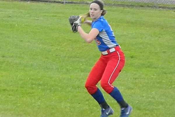 Freshman right fielder Adriana Favreau guns the ball back to the infield to hold the runner
