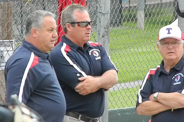 Assistant coaches Todd DiRocco and Derek Doherty talk strategy with head coach Doc DiRocc