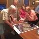 Residents glance over the preliminary drawing of plans for a residential development for 300 Ames Pond Drive.