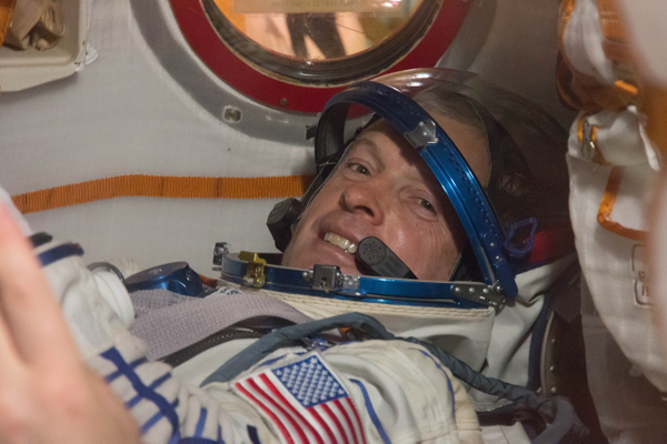 Steve Swanson of NASA poses for a picture in the Soyuz TMA-12M spacecraft. (#1)