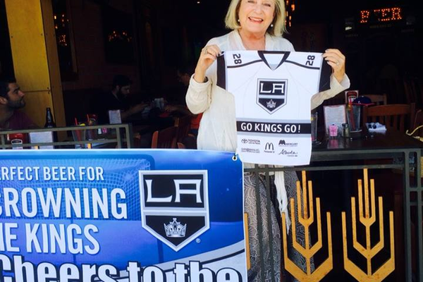 Angela Silverman enjoys some Kings gear.