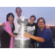 Mayor Amy Howorth enjoys a special Stanley Cup moment with Coach Darryl Sutter, his son Chris and Mike Zislis.