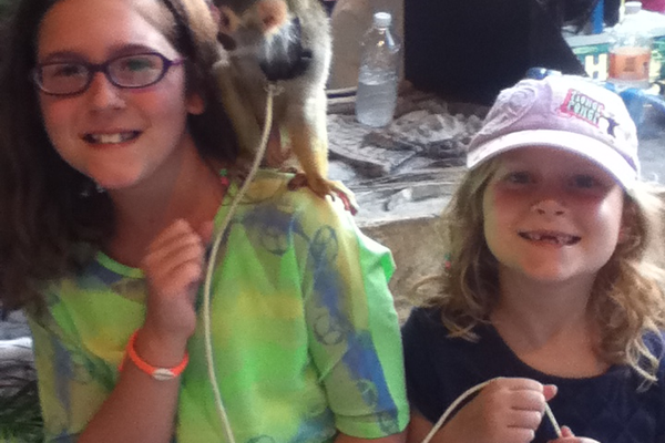 Paige and Carly with a monkey in Mexico