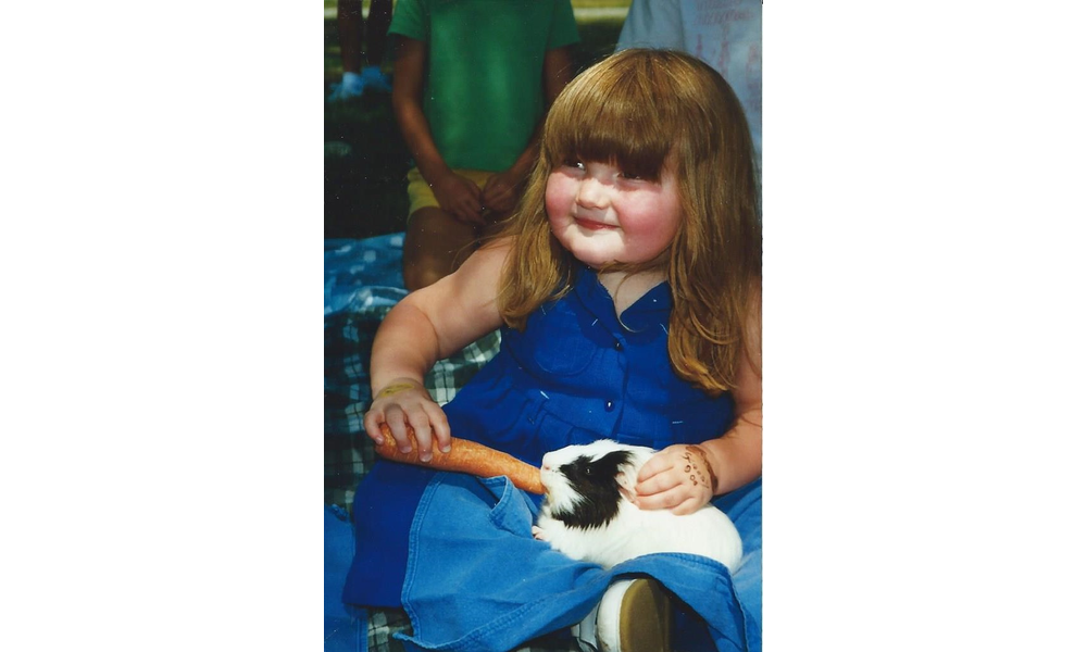 Little girl feeding guinea pig.jpg