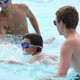 Lifeguards watch over a swimmer at the CDA swim club's annual races July 22, 2014. (Photo by Kyle Kondor.)