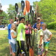 Damien, Kavya, Divya, Katherine, Abhi, Jonah and Eric stand with instructor David Cudmore during one of the team building exercises at Adventure Kids kayak camp on Long Pond.