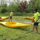 Abhi and Jonah get the kayaks back up on dry land after their time on Long Pond.