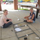Lori Hanley and Stacy Finnegan assemble a ladder for one of the structures. Photo by Paige Impink.
