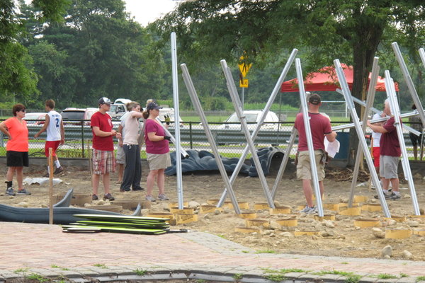 Volunteers get posts in place for the Age 2-5 structure. Andrea Regina, Jayne Miller, Lori Hanley, Scott Pastorello, Luke Miller. Photo by Paige Impink.