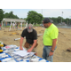 Site Manager Andy Berger and DPW Highway Supervisor Pete Cook go over some plans during to the build at the playground. Photo by Paige Impink.
