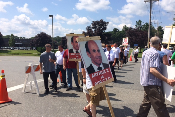 Striking workers picket the DeMoulas Headquarters on East Street.