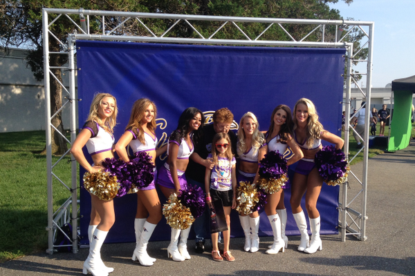 Fans pose for pictures with the Baltimore Ravens cheerleaders.