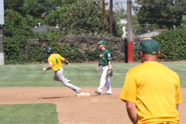 Jason Schwartz, in 2014 competition, rounding second base on a double he hit to left field.