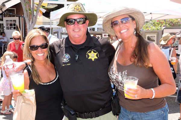Lisa and Shelly's annual photo with detective Trey Hunt.