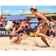 April Ross gets the ball as teammate Kerri Walsh Jennings moves into position. Photo: AVP/Robert Beck
