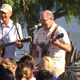 "Judge Rick Lyman and veteran Jeff Eick sing ""This Land Is Your Land"""