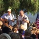 """Judge Rick Lyman and veteran Jeff Eick sing """"This Land Is Your Land"""""""